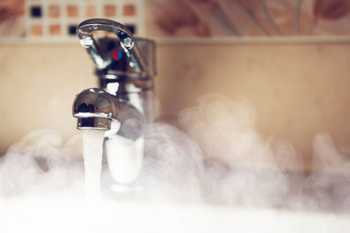 What is an indirect-fired water heater?